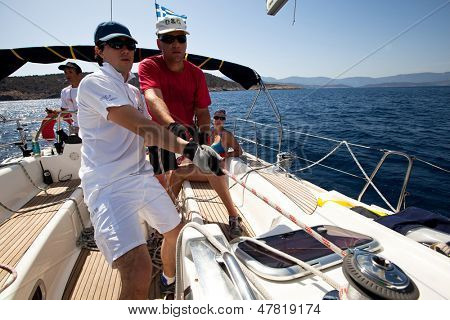 SARONIC GULF, GREECE - SEPTEMBER 25: Unidentified sailor participates during of sailing regatta