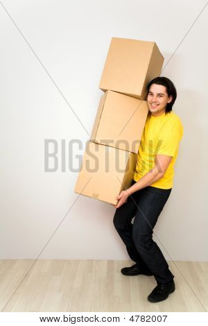 Young Man Carrying Boxes