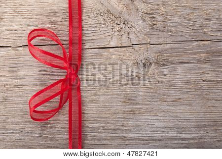 A Red Bow On Wood