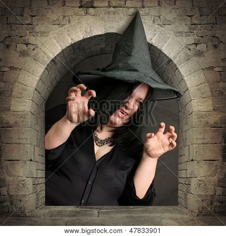 Scary witch rising from the vault. Halloween theme.