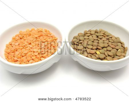 Two Bowls Of Chinaware With Lentils And Red Lentils