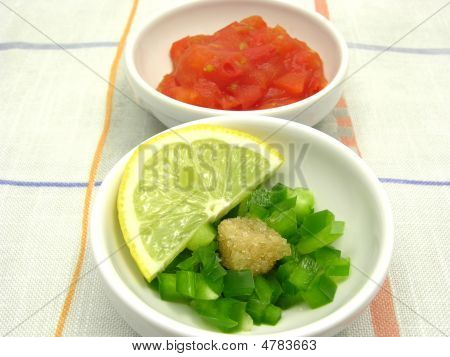 Little Bowls Of Chinaware With Tomatodip And Green Pepperdip