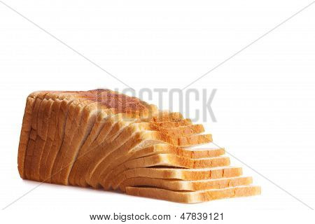 Sliced white loaf of bread on white background
