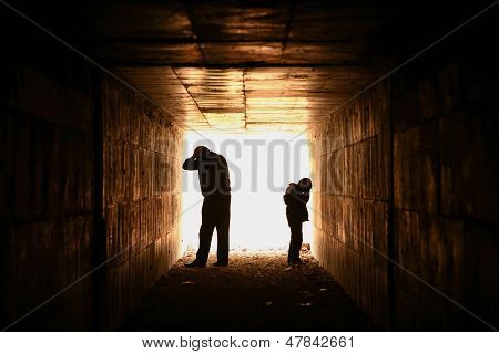Man And Child Silhouette In Tunnel