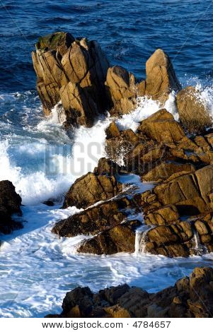 Waves Crashing Through Rocks