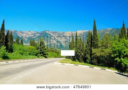 The Road In The Mountains Of Spruce And Cypress Trees