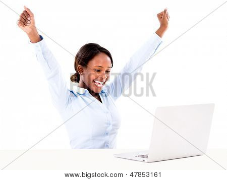 Business woman celebrating her online success - isolated over white
