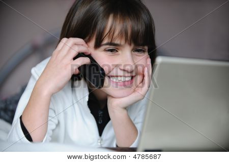 Child On Lap Top And Phone