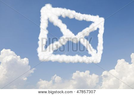 Email and mail communication concept symbol in clouds on blue sky
