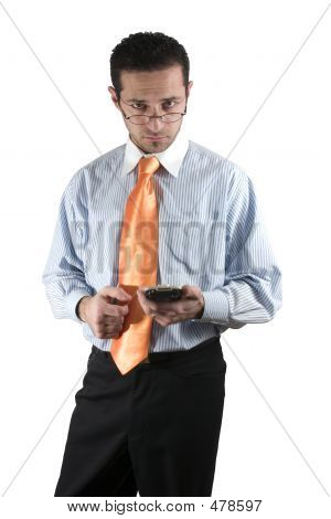 Businessman Looking Over His Glasses With Pda On Hand