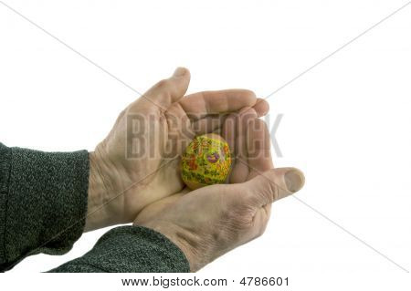 Man's Hands Hold Decorated Easter Egg Isolated Over White Background