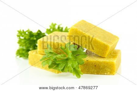 Bouillon cubes with parsley, isolated on white