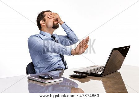 upset businessman with eyes closed by hand is against xxx & porno online