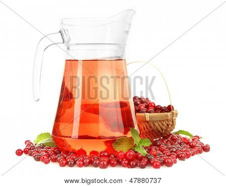 Pitcher of cranberry juice with cranberries, isolated on white