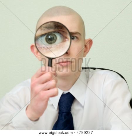 Guy Looks Through The Big Magnifier