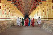 pic of indian sari  - A group of Indian pilgrims going through the corridor of pillars in Ramanathaswamy Temple biggest temple of Rameshwaram Tamil Nadu India - JPG