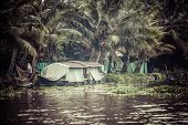 foto of alleppey  - House boat in backwaters near palms in Alappuzha Kerala India - JPG