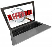 stock photo of recommendation  - A modern silver or aluminum laptop computer with a screen showing a magnifying glass over the word Referral to illustrate the search for a recommendation or someone to refer you - JPG