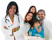 stock photo of pediatric  - Smiling friendly Indian female medical doctor and patient family - JPG