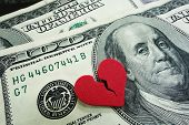 image of breakup  - closeup of a broken red heart on cash  - JPG