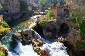Village With Waterfall, Provence, France.