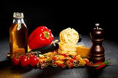 Pasta ingredients on black table, italian cuisine concept