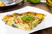 stock photo of italian parsley  - Italian frittata with vegetables and parmesan cheese - JPG