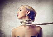 image of strangling  - beautiful woman kidnapped with rope around the neck - JPG