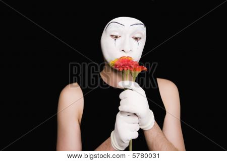 Portrait Of  Mime In White Gloves With Flowers