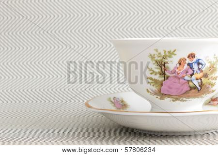 Vintage Tea Cup Over Background With  Zigzags
