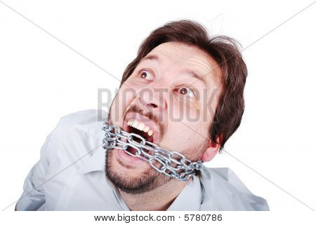 Young Male Is Screaming With Chain In Mouth