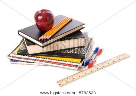 Apple And School Supplies On A White Background