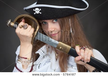 Girl In Pirate Hat With A Sabre In Hands