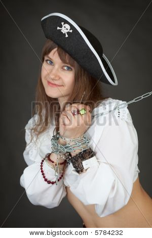 Young Sexy Girl In A Costume Pirate Chained In A Chain