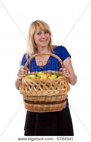 Girl With A Basket Full Of Fruits