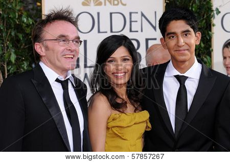 Danny Boyle with Freida Pinto and Dev Patel at the 66th Annual Golden Globe Awards. Beverly Hilton Hotel, Beverly Hills, CA. 01-11-09