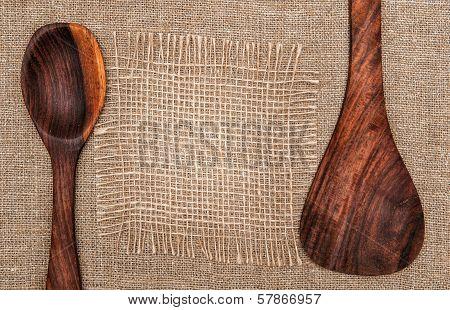 Wooden Utensils On Burlap Background