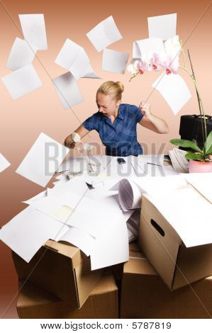 businesswoman in her office and flying paper sheets