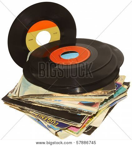A pile of 45 RPM vinyl records used