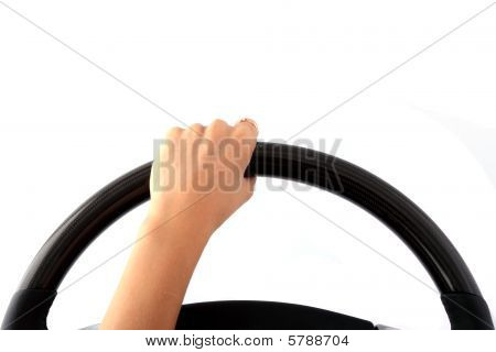 Female Hand On A Steering Wheel