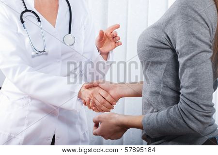 Friendly, happy doctor with stethoscope