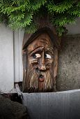 stock photo of hobgoblin  - hobgoblin out of wood guards the entrance