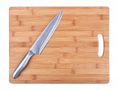Kitchen Cutting Board And A Large Kitchen Knife. Close-up.