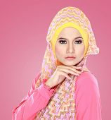 pic of hijabs  - Fashion portrait of young beautiful asian muslim woman with pink costume wearing hijab - JPG