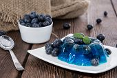 foto of jello  - Portion of Blueberry Jello on wooden background - JPG