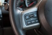 stock photo of steers  - Audio control buttons on the steering wheel of car