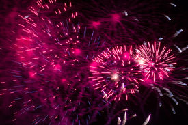 picture of guy fawks  - Pink fireworks exploding at night during Guy Fawkes - JPG