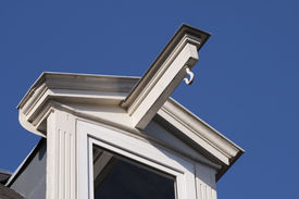 picture of gabled dormer window  - White dormer window of an old house in Amsterdam, with a blue sky in the background ** Note: Slight blurriness, best at smaller sizes - JPG
