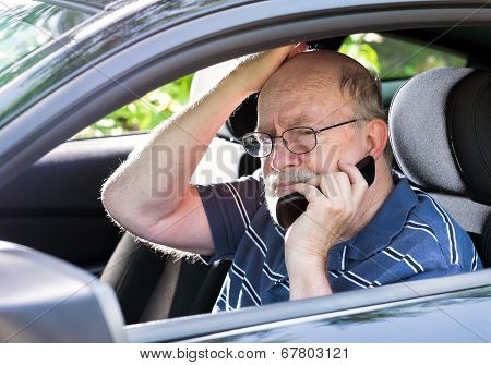 Frustrated Elderly Man in Car on Cell Phone.