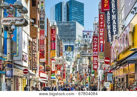 TOKYO, JAPAN - MARCH 31, 2014: Pedestrians stroll down Shibuya Cener-gai. The area is a popular destination for fashion and shopping.